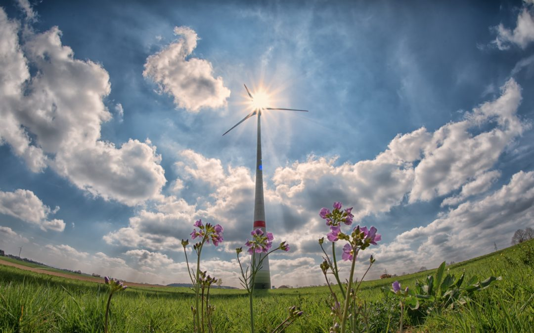wind turbines with the sky in their back to ishow renewable energies